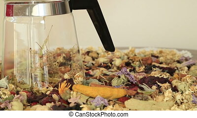 Teapot with different kind of healing herbs - View of...