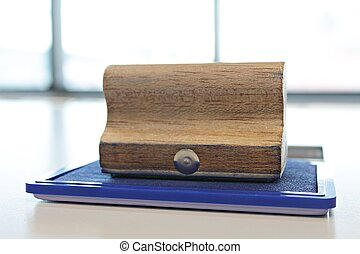 Blue ink color stamp box and wooden rubber stamp on the  table