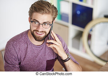 High angle view on man with mobilephone
