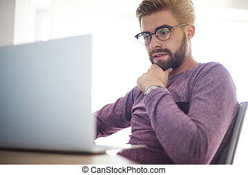 Pensive and focused man in front of the computer