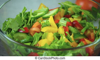 Salad of fresh vegetables rotate in a circle. Arugula,...