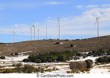 aerogenerator windmills on snow mountain - aerogenerator...