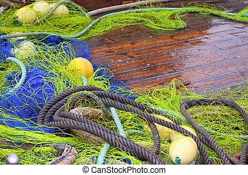 fishemen professional tackle net boat wood deck