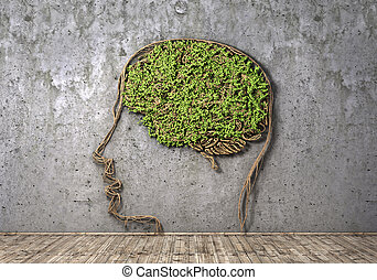 Concept of thinking. The green plant in form of human head...