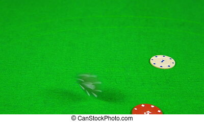 casino chips falling on a table