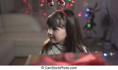 Girl Suprised by Gift Box - Young happy smiling surprised...