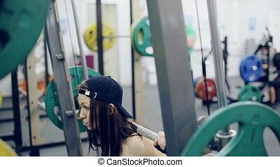 Girl doing barbell full squat exercise - Womans Barbell Full...