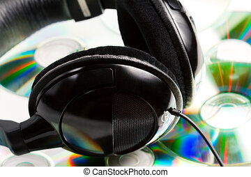 Headphones on top of audio cds - Modern music concept -...