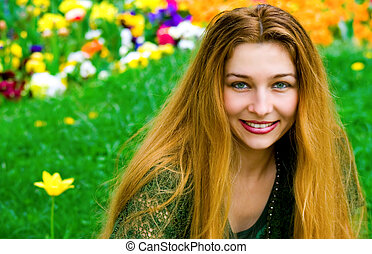 Young woman and flowers in background