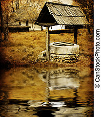 Ancient water well - Sepia image of ancient water well in...