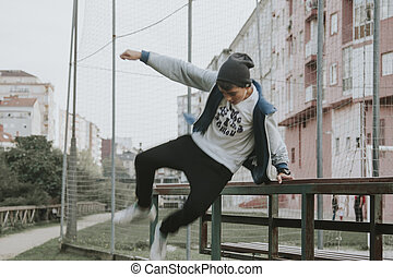 child outdoors practicing parkour