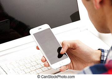 hands with mobile phone and computer