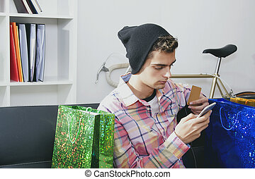 man with the mobile phone and credit card