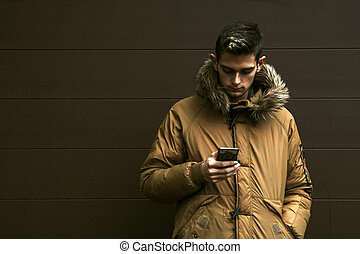 man with mobile phone and outerwear