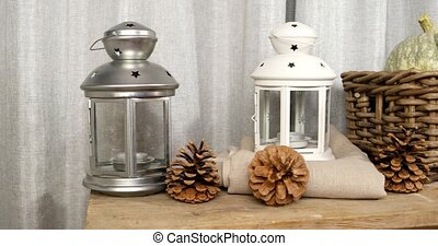 Still life with pumpkins, pine cones and lanterns. UltraHD...