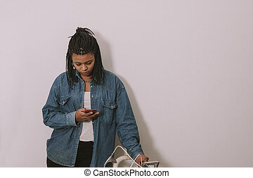 girl young's style casual with the phone mobile in the wall...