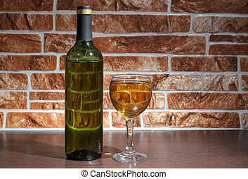 Wineglass and stones wall - Glass and bottle wine on wooden...
