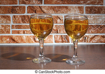 Wineglass and wall - Glass and bottle wine on wooden table