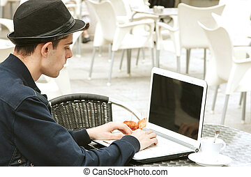 young man with the laptop in the coffee shop