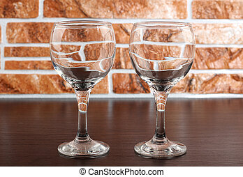 Wineglass on dark table - Glass and bottle wine on wooden...