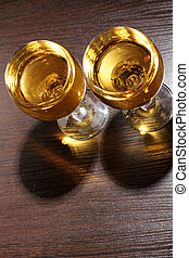 Wineglass on wood table - Glass and bottle wine on wooden...