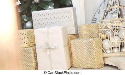 Cristmas gift box near xmas tree