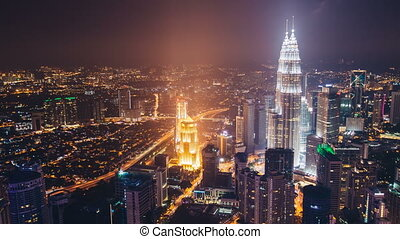 Rooftop time-lapse of skyscraper petronas towers in Kuala Lumpur