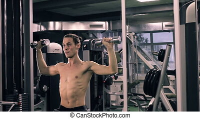 Muscular Man Working Out With Dumbbells - Fitness And...