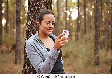 Lovely smiling girl looking at selfie