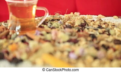 Tea with different kind of healing herbs - Overhead view of...