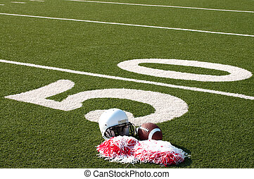 American Football, Helmet and Pom Poms on Field - American...