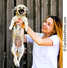 Happy moment - cute woman and her funny dog - Happy moment -...