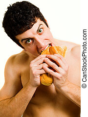 Unhealthy food - hungy man eating bread isolated on white