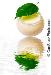 Beauty cream and fresh leaf over water