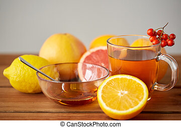 tea with honey, lemon and rowanberry on wood - health,...