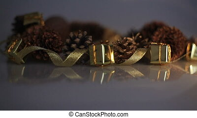 pine cones and tape boxes with gifts. Christmas table decorations