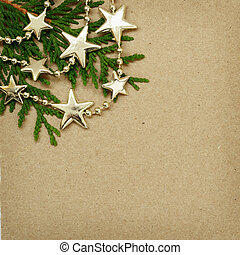 Brown cardboard with evergreen twigs and Chrisrmas garland...