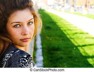 Outdoor portrait of one beautiful woman