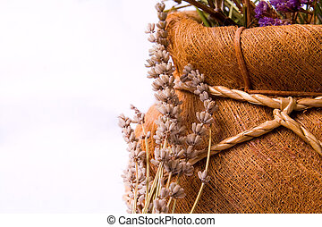 Aromatherapy: lavender flowers and decorative basket -...