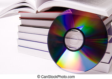 Audio book concept - pile of books and one cd over white