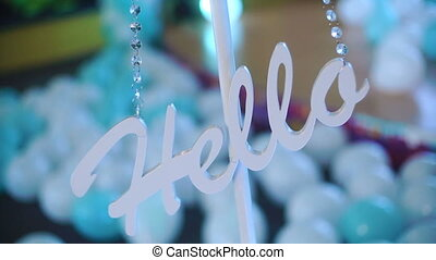 Hello written in a whiteboard on the blur background.