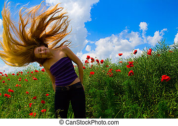 Woman with moving hair in poppy field - Blond beautiful...