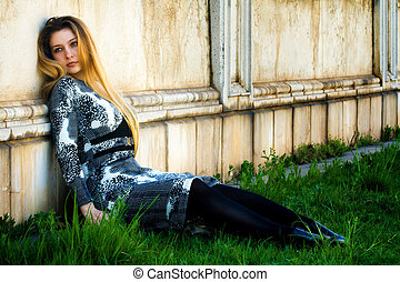 Depressed young woman and grungy wall - Portrait of...