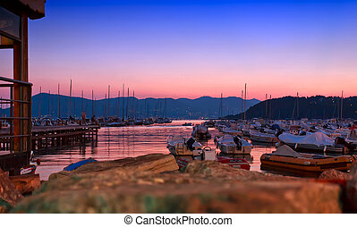 Beautiful sunset above many yachts in Mediterranean sea in...