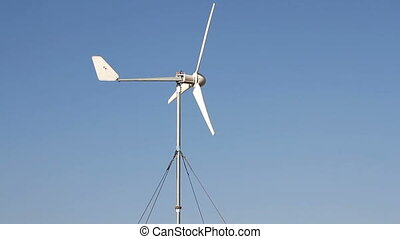 Row of wind power generator over blue sky