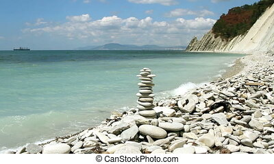 stack of zen stones on the beach