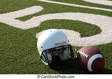 American Football Equipment on Field - American football and...