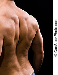 Man with big muscular back on black background