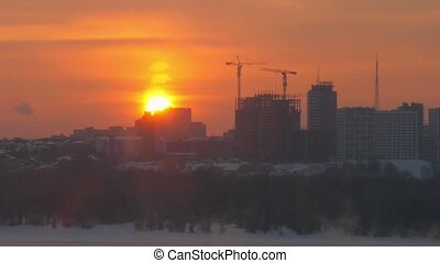 Timelapse of view of Novosibirsk from the height at sunset....