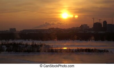 View of Novosibirsk from the height at sunset in winter....